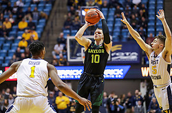Jan 21, 2019; Morgantown, WV, USA; Baylor Bears guard Makai Mason (10) shoots a jumper during the first half against the West Virginia Mountaineers at WVU Coliseum. Mandatory Credit: Ben Queen-USA TODAY Sports