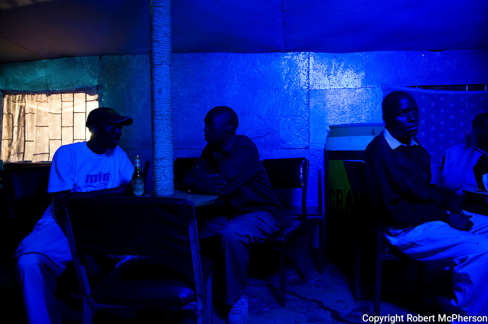 KENYA. Nairobi. Local pub in the slum of Kibera...Kibera is Africa's largest slum and it is located in Nairobi, Kenya. It houses one million people squeezed into less than a square mile.