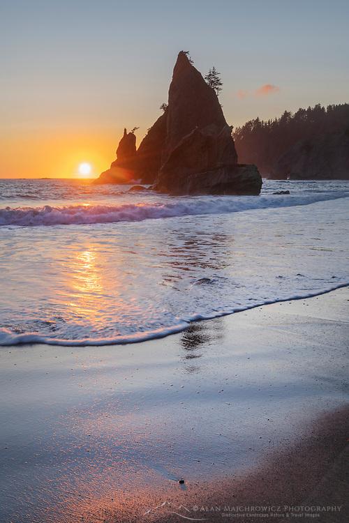 Sun setting behind Split Rock on Rialto Beach Olympic National Park Washington