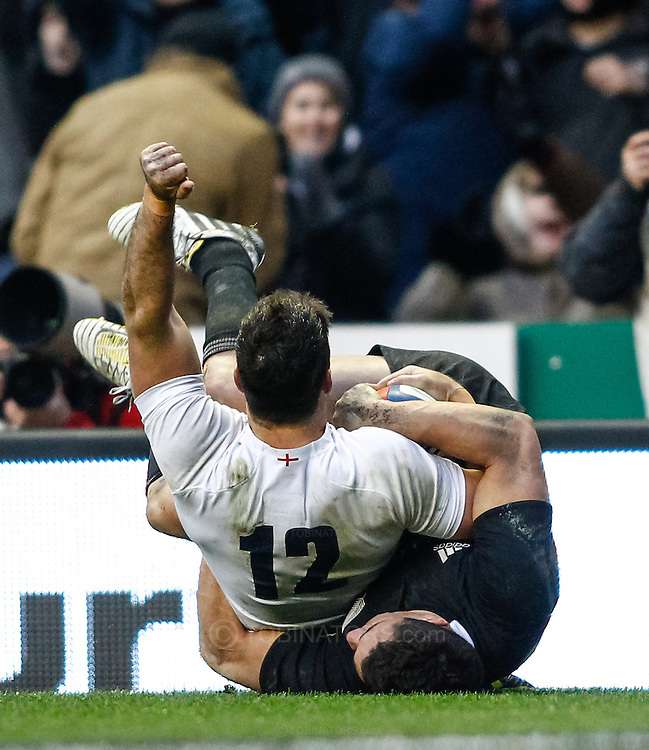 Picture by Andrew Tobin/SLIK images +44 7710 761829. 2nd December 2012. Brad Barritt of England scores as he is tackled by Dan Carter of New Zealand during the QBE Internationals match between England and the New Zealand All Blacks at Twickenham Stadium, London, England. England won the game 38-21.