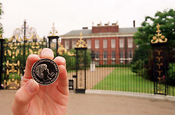 One of the special 5 coin commemorating the life and work of Diana, Princess of Wales, outside her former home, Kensington Palace in London. The coin is made available to the public, on what would have been the Princess s 38th birthday.   *The twin-headed coin, produced by the Royal Mint, features a portrait of Diana in profile by David Cornell, with a portrait of the Queen on the other side.  All proceeds from the coin will go towards projects recommended by the Memorial Committee set up in her name.