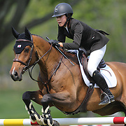Karen Polle riding With Wings in action during the $100,000 Empire State Grand Prix presented by the Kincade Group during the Old Salem Farm Spring Horse Show, North Salem, New York,  USA. 17th May 2015. Photo Tim Clayton