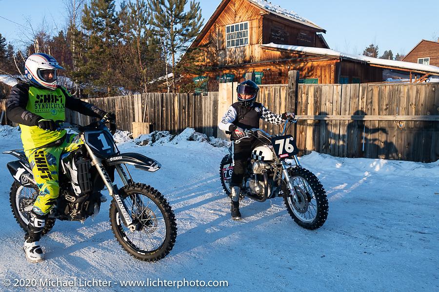 Mikhail Mikhin (L) and Moscow photographer Aleksei Kalabin on his Kawasaki w650 racer after the Baikal Mile Ice Speed Festival. Maksimiha, Siberia, Russia. Monday, March 2, 2020. Photography ©2020 Michael Lichter.