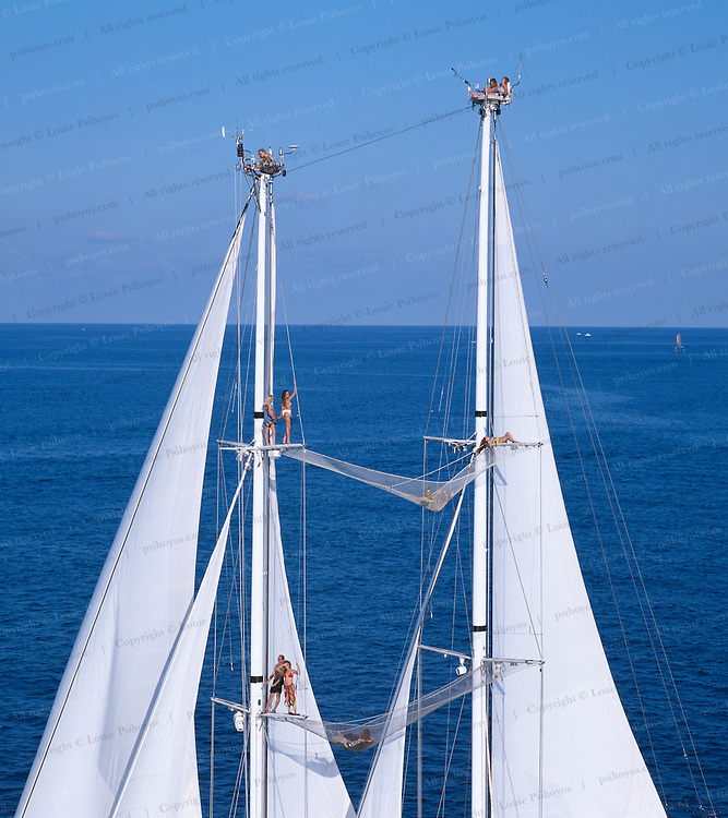 The Starship Andromeda, a two-masted schooner, is a superyacht with an enormous amount of locations for guests to enjoy the view while aloft including sky lounges atop the masts.