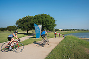 Riders cross over the Trinity River on the Trinity Trail during the first day of the 2014 Tour de Fort Worth, an annual event hosted by Mayor Betsy Price to promote cycling within the city while also giving her a chance to connect with her constituents on July 5, 2014 in Fort Worth, Texas. (Cooper Neill for The New York Times)