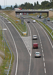 © Licensed to London News Pictures. 27/07/2011. Hindhead, Surrey, UK. Today (Wednesday) The £371 Million Hindhead Tunnel project officially opens to the public. Pictured: The first traffic to use the tunnel continues on to the new stretch of the A3 towards Portsmouth. Photo credit: Sam Spickett/LNP