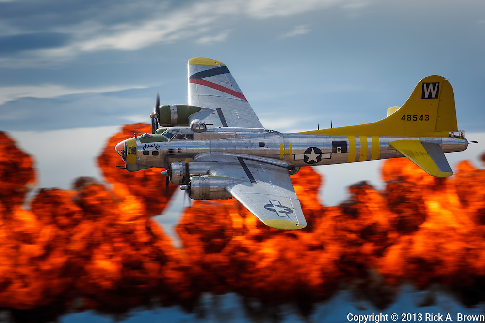 """Brent Conner flies Tillamook Air Museum's B17 """"Chuckie"""" past the """"Wall of Fire"""" at the Airshow of the Cascades."""