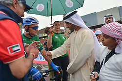 March 1, 2019 - Ajman, United Arab Emirates - Sheikh Ahmed bin Humaid Al Nuaimi, Chairman of the Economic Department of Ajman Emirate meets with the Green Jersey (General Points), Stepan Kurianov of Rusia and Team Gazprom-Rusvelo, at the start line of the sixth Rak Properties Stage of UAE Tour 2019, a 180km with a start from Ajman and finish in Jebel Jais. .On Friday, March 1, 2019, in Ajman, Ajman Emirate, United Arab Emirates. (Credit Image: © Artur Widak/NurPhoto via ZUMA Press)