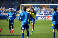 AFC Wimbledon defender Darnell Johnson (27) warming up prior to kick off during the EFL Sky Bet League 1 match between AFC Wimbledon and Hull City at Plough Lane, London, United Kingdom on 27 February 2021.