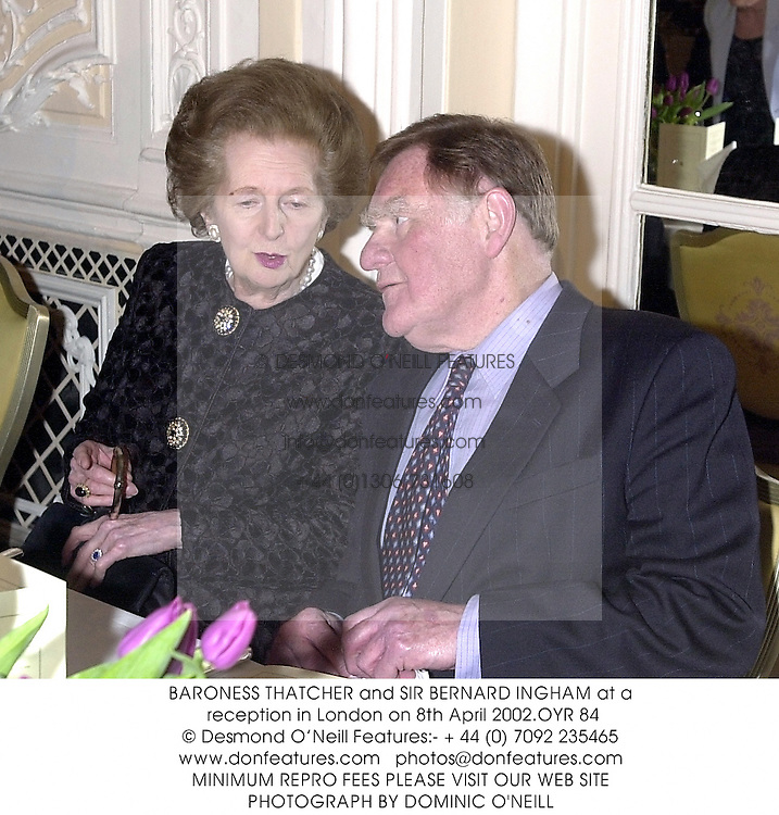 BARONESS THATCHER and SIR BERNARD INGHAM at a reception in London on 8th April 2002.OYR 84