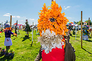 Mr Tod by Nonsuch Primary School - The schools scarecrow area - Preparations for the Hampton Court Flower Show, organised by teh Royal Horticultural Society (RHS). In the grounds of the Hampton Court Palace, London.