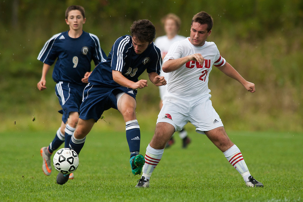 Essex's Danilo Salgado (23) and CVU's Will Yakibuk (21) battle for the ball during the boys varsity soccer game between the Essex Hornets and the Champlain Valley Union Redhawks at CVU High School on Wednesday afternoon September 9, 2015 in Hinesburg. (BRIAN JENKINS/for the FREE PRESS)