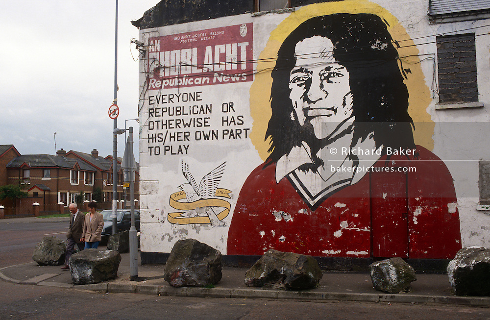 "The face of the Irish Republican Bobby Sands is painted on the office wall of Sinn Feinn, the left-wing politcal arm of the Irish Republican Army (IRA) in Belfast, Northern Ireland. Robert Gerard ""Bobby"" Sands (1954 - 1981) was an Irish volunteer of the Provisional Irish Republican Army and member of the British Parliament who died on hunger strike while imprisoned in HM Prison Maze. He was the leader of the 1981 hunger strike in which Irish republican prisoners protested against the removal of Special Category Status. During his strike he was elected as a member of the British Parliament as an Anti H-Block/Armagh Political Prisoner candidate. ."