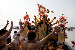 © under license to London News Pictures.  17/10/2010 ©London News Pictures. 17/10/2010. Devotees pay there final respects to the  Hindu goddess Durga before immersing it in the river Ganges on the last day of the Durga Puja festival on October 17, 2010 in Kolkata, India. The festival is the biggest of the year in the Indian state of Bengal and celebrates the worship of the Hindu Goddess Durga, who in Hindu Mythology is celebrated as the Goddess of power and the victor of good over evil.