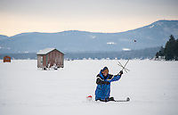 Dan Maloney of Nottingham sets a tip up on Meredith Bay Friday morning in preparation for the Great Meredith Rotary Ice Fishing Derby.  (Karen Bobotas/for the Laconia Daily Sun)