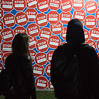 Visitors watch politics themed billboards reacting to Hungarian government's Stop Soros election campaign on display at the Arc Billboard social issues exhibition in Budapest, Hungary on Sept. 24, 2018. ATTILA VOLGYI