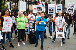 London, UK. 26 June, 2019. Campaigners against knife crime, including families who have lost loved ones to knife crime, protest with fake blood outside Parliament as part of Operation Shutdown to put pressure on the Government, and in particular the next Prime Minister, to take urgent action to prevent knife crime and to protect its citizens.