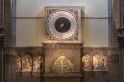 """THEMENBILD - Die Kathedrale Santa Maria del Fiore (italienisch Cattedrale di Santa Maria del Fiore) in Florenz ist die Bischofskirche des Erzbistums Florenz und somit Metropolitankirche der Kirchenprovinz Florenz. Ihre gewaltige weltbekannte Kuppel, das Hauptwerk Brunelleschis, gilt als technische Meisterleistung der frühen Renaissance. Hier im Bild Im Innern oberhalb des Hauptportals befindet sich die große Uhr mit Freskenschmuck von Paolo Uccello, der in den Ecken in Rundmedaillions die vier Propheten<br /> oder Evangesisten darstellt (1443). Diese liturgische Uhr zeigt die 24 Stunden der hora italica (ltalienische Zeit), eine Zeitspanne, die mit dem Sonnenuntergang nach 24 Stunden endet. Diese Zeiteinteilung fand bis zum 18. Jh. Verwendung. Es handelt sich um eine der wenigen Uhren aus dieser Epoche, die noch existiert und funktionstüchtig ist. Aufgenommen am 18. Oktober 2015 // SThe Cattedrale di Santa Maria del Fiore (English, """"Cathedral of Saint Mary of the Flower"""") is the main church of Florence, Italy. Il Duomo di Firenze, as it is ordinarily called, was begun in 1296 in the Gothic style to the design of Arnolfo di Cambio and completed structurally in 1436 with the dome engineered by Filippo Brunelleschi. The exterior of the basilica is faced with polychrome marble panels in various shades of green and pink bordered by white and has an elaborate 19th-century Gothic Revival façade by Emilio De Fabris. The cathedral complex, located in Piazza del Duomo, includes the Baptistery and Giotto's Campanile. The three buildings are part of the UNESCO World Heritage Site covering the historic centre of Florence and are a major attraction to tourists visiting the region of Tuscany. The basilica is one of Italy's largest churches, and until development of new structural materials in the modern era, the dome was the largest in the world. It remains the largest brick dome ever constructed.. Pictured on 18. October 2015. EXPA Pictures © 2015, PhotoCredit: EXPA/ Johann Grode"""