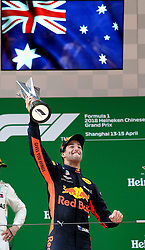SHANGHAI, April 15, 2018  Red Bull's driver Daniel Ricciardo of Australia celebrates with his trophy on the podium after winning the Formula One Chinese Grand Prix in Shanghai, east China, April 15, 2018. Daniel Ricciardo claimed the title of the event in 1 hour, 35 minutes and 36.380 seconds.  dx) (Credit Image: © Fan Jun/Xinhua via ZUMA Wire)