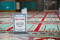 © Licensed to London News Pictures. 20/07/2020. London, UK. 'PRAY HERE - PLACE YOUR MAT IN THIS SPACE' sign at Wightman Road Mosque, also known as London Islamic Cultural Society and Mosque, in north London as the Mosque reopens for Zuhr (the afternoon prayer) after almost four months of lockdown. Last month the government announced that gatherings of more than 30 worshippers are allowed for acts of communal worship in churches, synagogues, mosques, temples and other places of worship. All worshippers attending Mosques have to wear face coverings and bring their own prayer mat, Quran, and a reusable shoe bag. Photo credit: Dinendra Haria/LNP