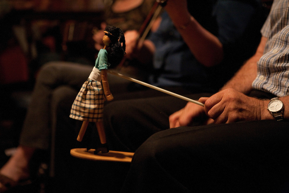 A man plays a limberjack, or gigueux, as a group of French-Canadian musicians gather for an evening of Quebecois music at a restaurant in Burlington, Connecticut.