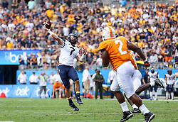 Sep 1, 2018; Charlotte, NC, USA; West Virginia Mountaineers quarterback Will Grier (7) throws a pass during the first quarter against the Tennessee Volunteers at Bank of America Stadium. Mandatory Credit: Ben Queen-USA TODAY Sports