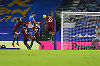 Football - 2020 / 2021 Premier League - Brighton and Hove Albion vs. Wolverhampton Wanderers - The Amex Stadium<br /> <br /> Lewis Dunk of Brighton climbs highest to head home the equaliser to earn Brighton a point at The Amex Stadium Brighton <br /> <br /> COLORSPORT/SHAUN BOGGUST