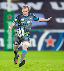 Luke Price of Ospreys kicks ahead<br /> <br /> Photographer Simon King/Replay Images<br /> <br /> European Rugby Champions Cup Round 1 - Ospreys v Munster - Saturday 16th November 2019 - Liberty Stadium - Swansea<br /> <br /> World Copyright © Replay Images . All rights reserved. info@replayimages.co.uk - http://replayimages.co.uk