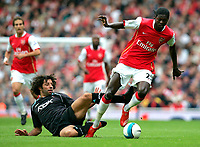Photo: Tom Dulat.<br /> Arsenal v Bolton Wanderers. The FA Barclays Premiership. 20/10/2007.<br /> Ivan Campo of Bolton Wanderers and Emmanuel Adebayor  of Arsenal with the ball.