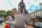 A right-wing protestor engage in a fierce verbal and physical attack against the press in front of the Winston Churchill statue during a rally in Parliament Square in London, Tuesday, June 9, 2020. Anger against systemic levels of institutional racism has raged through the city, and worldwide; sparked by the death of George Floyd, who was killed in Minneapolis, US, by a policeman who restrained him with force on 25 May 2020. (Photo/ Vudi Xhymshiti)