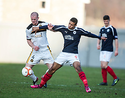 Dumbarton's Alan Lithgow and Falkirk's Lyle Taylor..Dumbarton 0 v 2 Falkirk, 23/2/2013..©Michael Schofield.