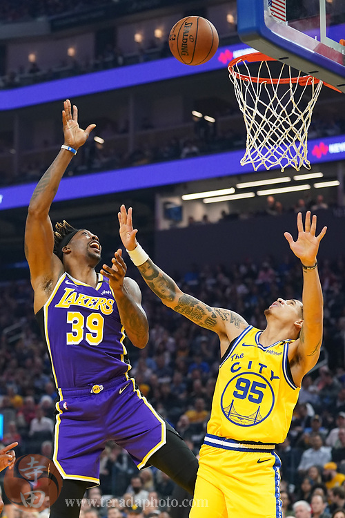 February 27, 2020; San Francisco, California, USA; Los Angeles Lakers center Dwight Howard (39) shoots the basketball against Golden State Warriors forward Juan Toscano-Anderson (95) during the first quarter at Chase Center.