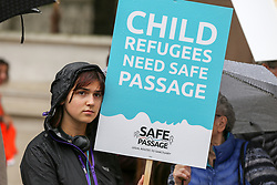 © Licensed to London News Pictures. 18/06/2019. London, UK. A campaigner from Safe Passage with a placard demonstrate in Parliament Square, calling on the Government to welcome 10,000 child refugees. Photo credit: Dinendra Haria/LNP