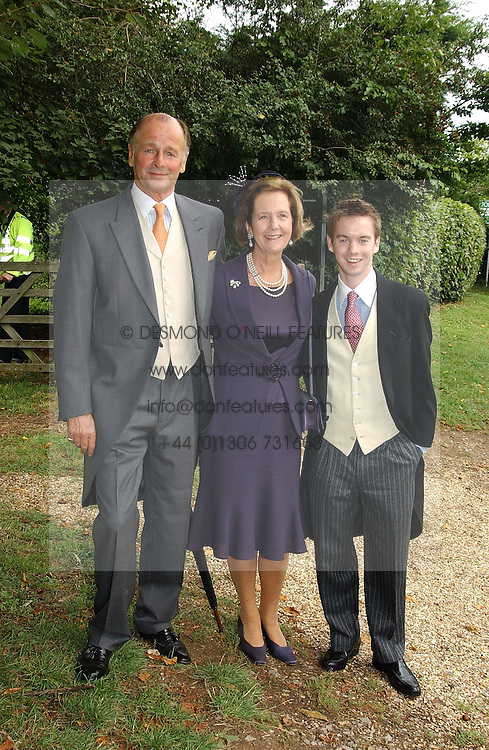 MR & MRS SIMON PARKER BOWLES, uncle of Tom Parker Bowles and theirn son SAM PARKER BOWLES at the wedding of Tom Parker Bowles to Sara Buys at St.Nicholas Church, Rotherfield Greys, Oxfordshire on 10th September 2005.<br />