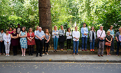 © Licensed to London News Pictures. 07/07/2015. London, UK. Members of the public observing one minute silence to pay their respects to 7/7 London bombings victims on the 10th anniversary of 7/7 London bombings in Tavistock Square on Tuesday, July 7, 2015. Photo credit: Tolga Akmen/LNP