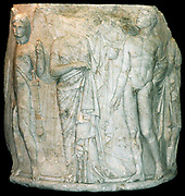 Sculpted marble column drum. Circa 325-300 BC. Found in Ephesus at the temple of Artemis. This view shows a youthful winged Thanatos (death), a draped woman (possibly Alcestis or Eurydice), and a figure of Hermes Psychopompos.
