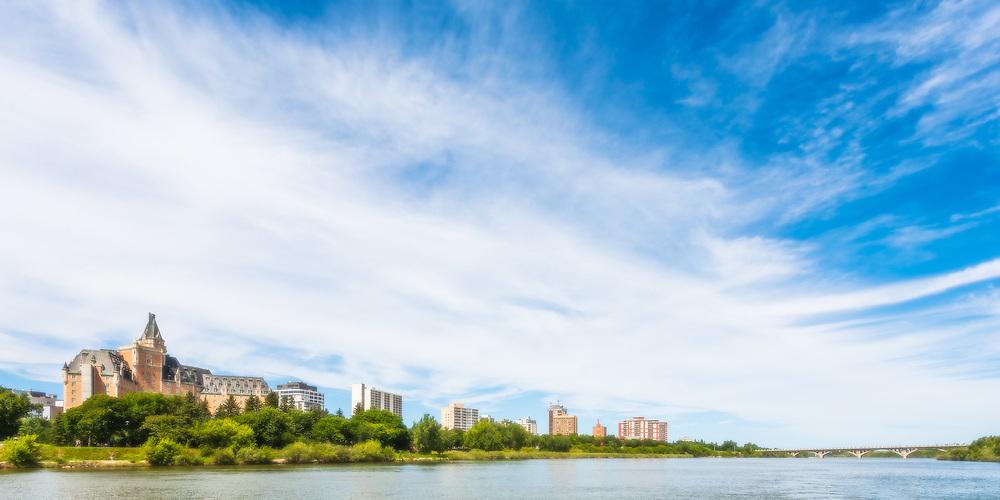 "Art in the Park 2016 City on the River, Saskatoon Skyline. 10"" x 20"" photographic print on aluminum."