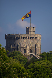 A huge Royal Standard, indicating that HM The Queen is in residence, flies from the flagpole on the Round Tower at Windsor Castle and Prince Harry and Meghan Markle marry.. Windsor, May 19 2018.