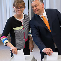 Hungarian Prime Minister Viktor Orban (L) with his wife Aniko Levai (R) cast their votes during the European Parliamentary election in Budapest, Hungary on May 26, 2019. ATTILA VOLGYI