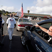SAN DIEGO, CA, MAY 5, 2007:  Members of the San Diego Minuteman organization, an anti-illegal immigration group, demonstrate at a day labor site in San Diego, California on May 5, 2007. The Minutemen harass those looking for work by questioning their legality. Their presence keeps employers from stopping to pick up the laborers. San Diego Minuteman founder Jeff Schwilk is seen in polo shirt and white, Minuteman hat with stars on the bill. Please contact Todd Bigelow directly with your licensing requests.