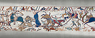 Bayeux Tapestry scene 53b: Norman cavalry attack Saxon soldiers ontop of a hill at the Battle of Hastings. .<br /> <br /> If you prefer you can also buy from our ALAMY PHOTO LIBRARY  Collection visit : https://www.alamy.com/portfolio/paul-williams-funkystock/bayeux-tapestry-medieval-art.html  if you know the scene number you want enter BXY followed bt the scene no into the SEARCH WITHIN GALLERY box  i.e BYX 22 for scene 22)<br /> <br />  Visit our MEDIEVAL ART PHOTO COLLECTIONS for more   photos  to download or buy as prints https://funkystock.photoshelter.com/gallery-collection/Medieval-Middle-Ages-Art-Artefacts-Antiquities-Pictures-Images-of/C0000YpKXiAHnG2k