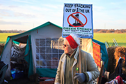 © Licensed to London News Pictures. 16/01/2014. Barton Moss, UK Anti Fracking protestors at Barton Moss, Salford today 16th January 2014. The energy company IGas has been granted permission to build a vertical test well at the site in Barton Moss, between Barton Aerodrome and the M62 motorway. Photo credit : Steven Purcell/LNP