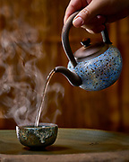 Oolong tea poured from a rock mineral pot.