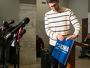 07 FEBRUARY 2020 - DES MOINES, IOWA: A person with the Iowa Democratic Party sets up the podium before a press conference Friday about the results of the Iowa caucuses, which took place Monday night, February 3. The results tally was delayed on caucus night because of unexpected problems with the reporting app. Troy Price, chair of the IDP, announced that Pete Buttigieg finished with a tiny lead over Bernie Sanders and that presidential campaigns would have until Monday February 10 to request a recanvass of caucus results.       PHOTO BY JACK KURTZ