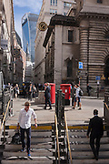Commuters and lunchtime pedestrians pass Bank Underground station on the corner of Lombard and King William Streets on 12th September, in the City of London, UK.