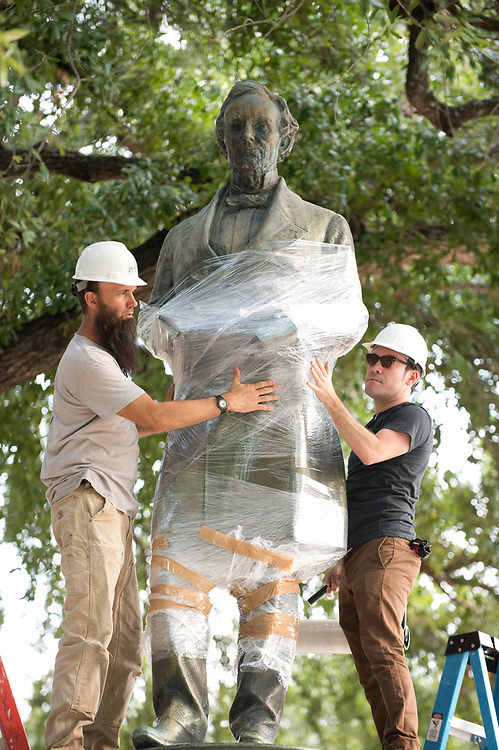 A 1933 statue of Confederate leader JEFFERSON DAVIS  is removed from University of Texas' South Mall Sunday after UT President Gregory Fenves cleared it to be placed in a campus museum along with a companion statue of President Woodrow Wilson. Racially-motivated  shootings in the U.S. have called for reexamining  cultural icons of the Confederate South.