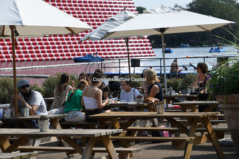 UK Weather: People enjoy breakfast playing at Lido Swimming as Heatwave continues in Hype park, London, UK. July 26 2018.