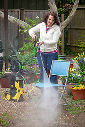 Cleaning garden furniture with a pressure washer