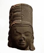 Head of Harihara  7th century, style of Phnom Da in Cambodia. sandstone, sculpture. Harihara is the name of a combined deity form of both Vishnu (Hari) and Shiva ( Hara) from the Hindu tradition. Also known as Shankaranarayana