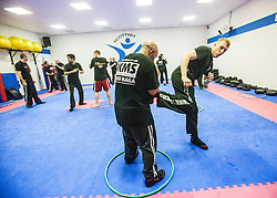 Kicking the hoop, during an exercise. Stef Noij, KMG Instructor from the Institute Krav Maga Netherlands, takes the IKMS G Level Programme seminar today at the Scottish Martial Arts Centre, Alloa.
